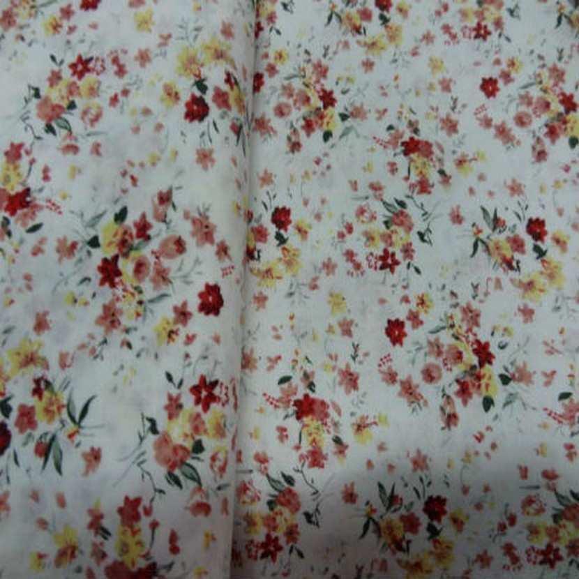 Coton blanc imprime petite fleurs ton rouge en 1 40m