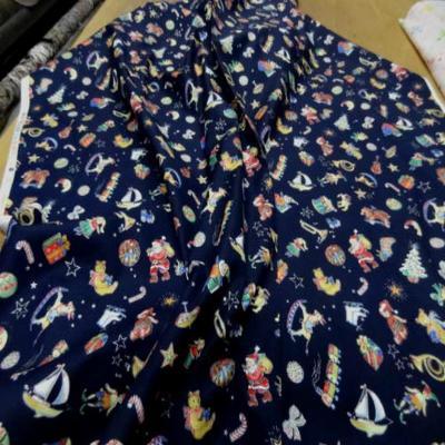 Coton bleu marine fonce imprime liberty motifs noel en 1 10m33