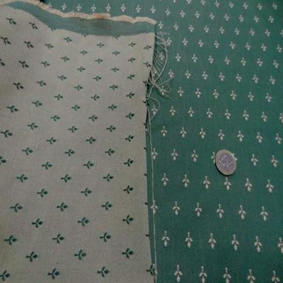 Coton faconne petite fleurs vert a motifs jaune