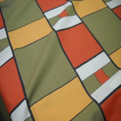Coton imprime ton kaki orange safran en 1 60m de large