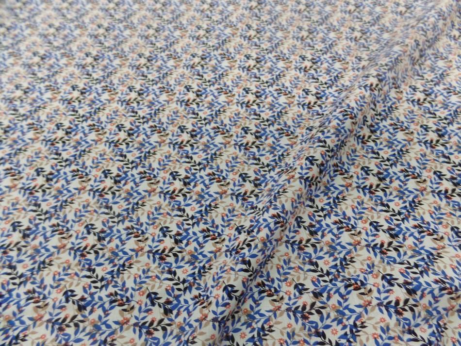 Coton popeline blanche imprimé liberty fleurs bleu et noir