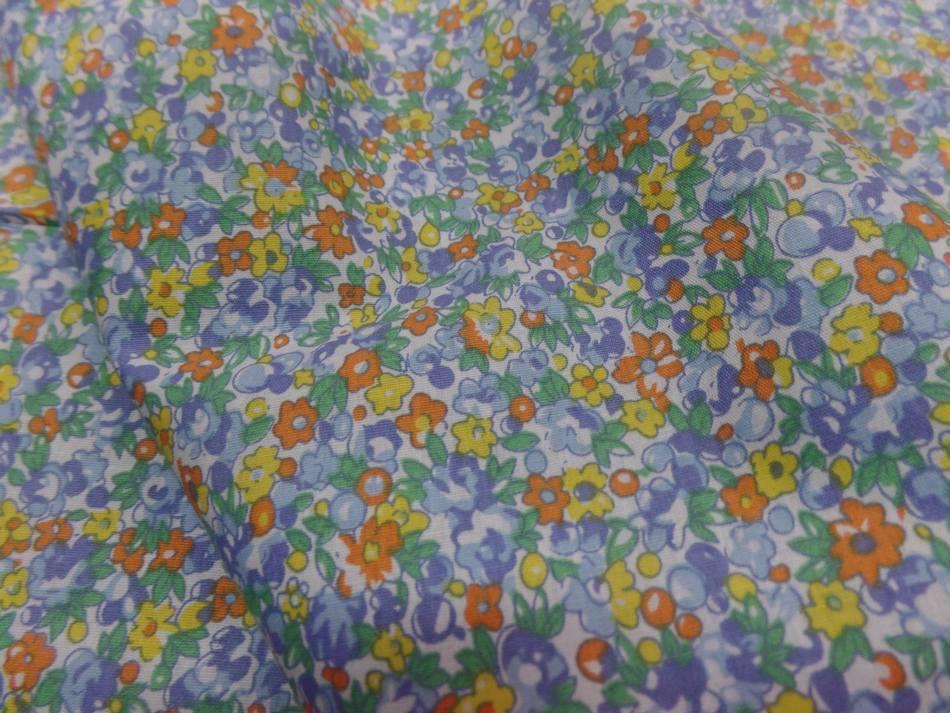 Coton popeline blanche imprime liberty fleurs bleu jaune orange