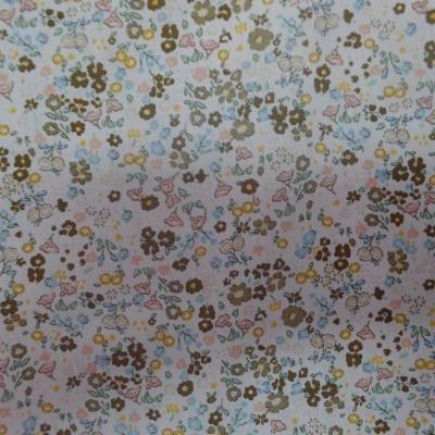Coton popeline blanche imprime liberty fleurs ton de terre
