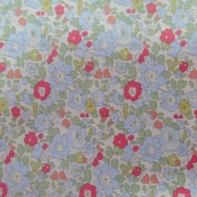 tissu coton 10%  popeline blanche imprimé liberty fleurs ton rouge,vert et bleu