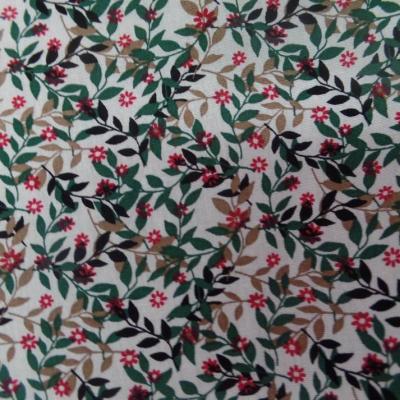 Coton popeline blanche imprime liberty fleurs vert noir et rouge