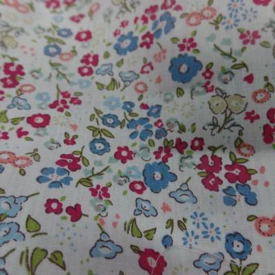Coton Coton popeline blanche imprimé liberty rouge , vert et bleu