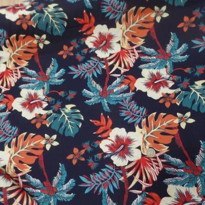 Coton popeline bleu nuit imprime hawaien ton rouge bleu blanc