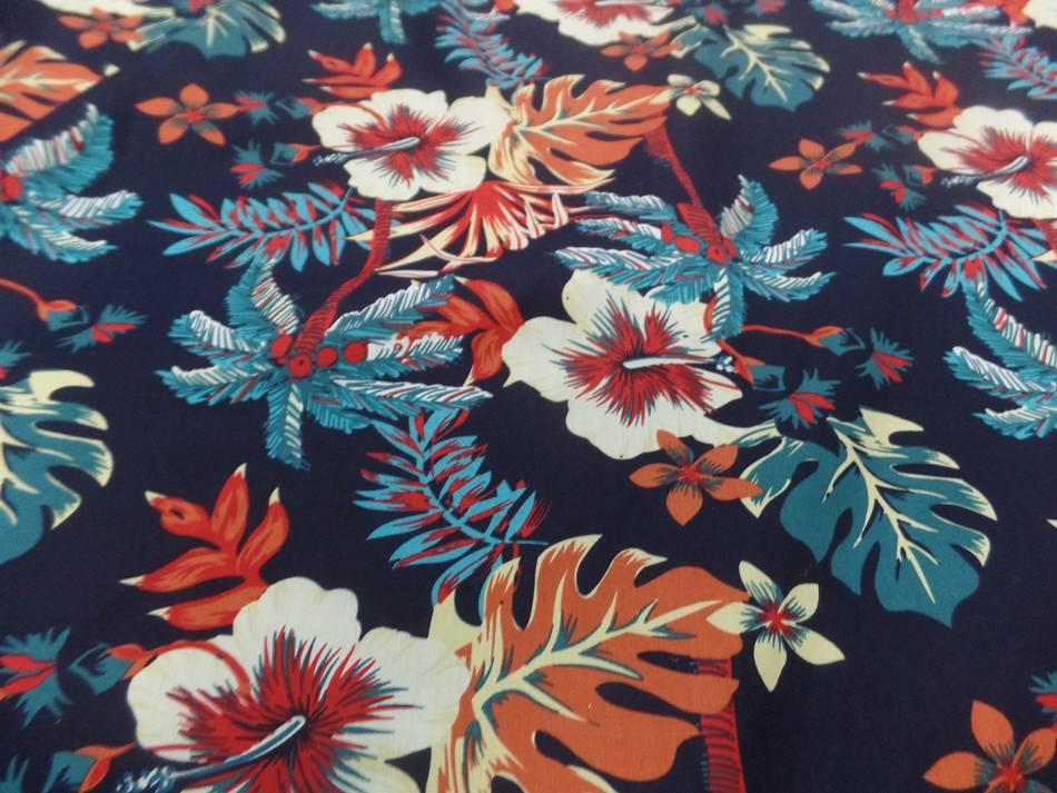 tissu Coton popeline bleu nuit imprimé hawaïen ton rouge bleu blanc