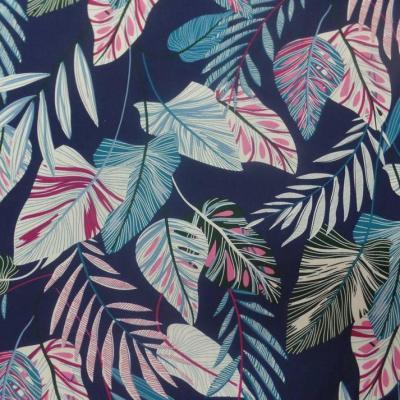 Coton popeline bleu nuit imprime motifs feuilles