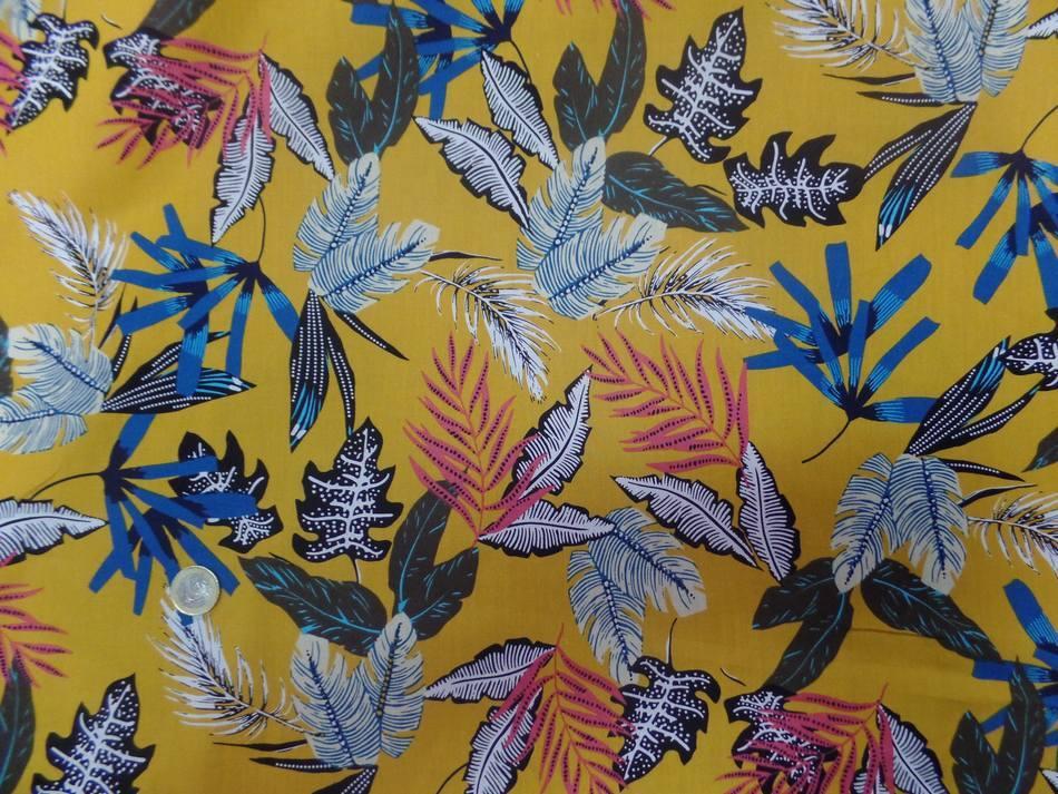 tissu coton popeline moutarde imprimé feuillages ton blanc , bleu, noir
