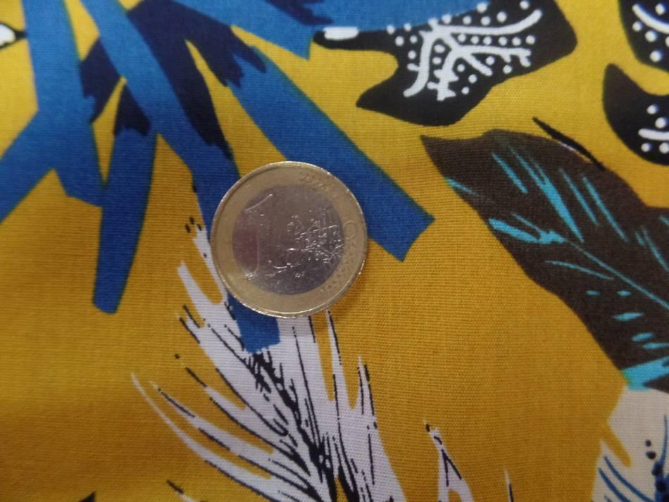 Coton popeline moutarde imprimé feuillages ton blanc , bleu, noir