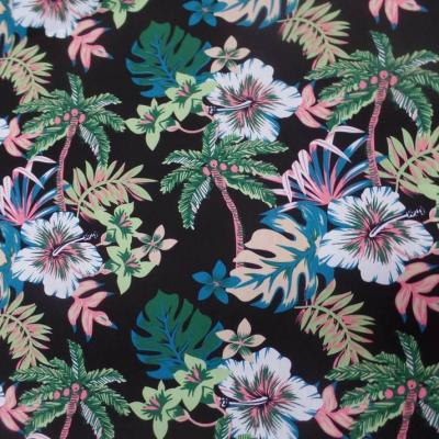 Coton popeline noire imprime hawaien ton vert blanc bleu