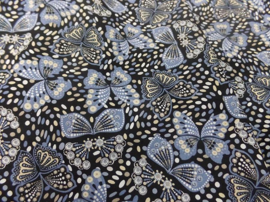 Coton popeline noire imprimé liberty papillon beige ,bleu et blanc