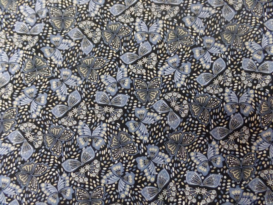 Coton popeline noire imprimé liberty papillon beige bleu et blanc