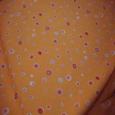 Coton ton orange imprime en 1 50m de large