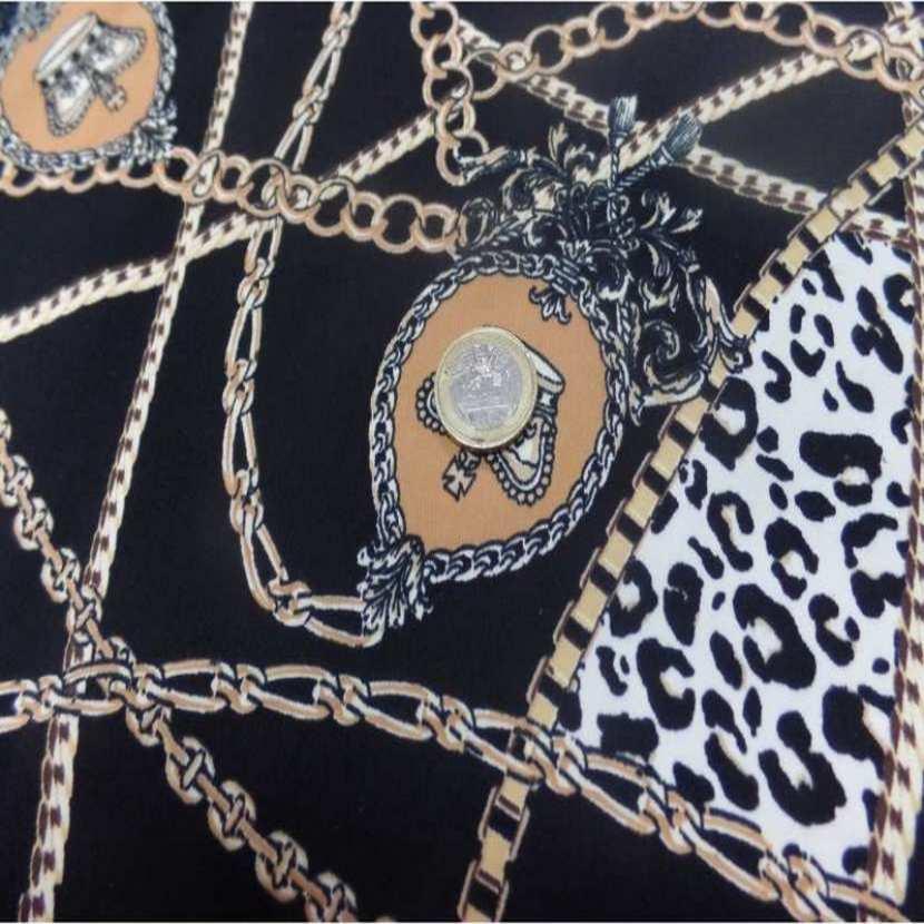 Coupon de gabardine coton lycra noire imprime dore 1 80m5