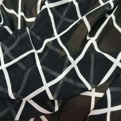 Coupon de mousseline noire a carreaux blanc 1 60m