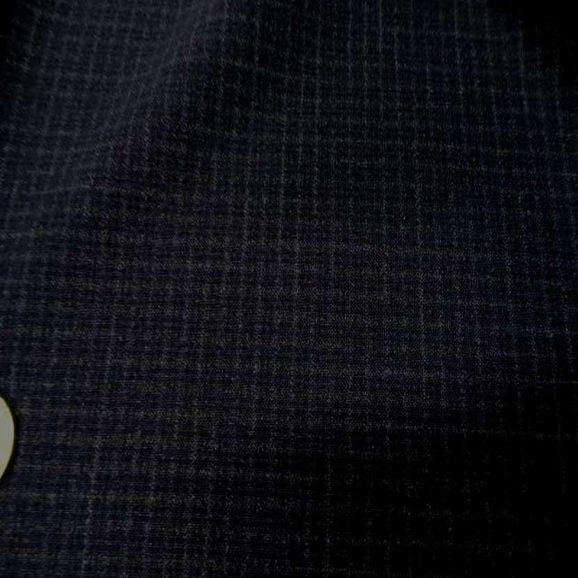 Coupon de tergal noir a petit carreaux 1 30m