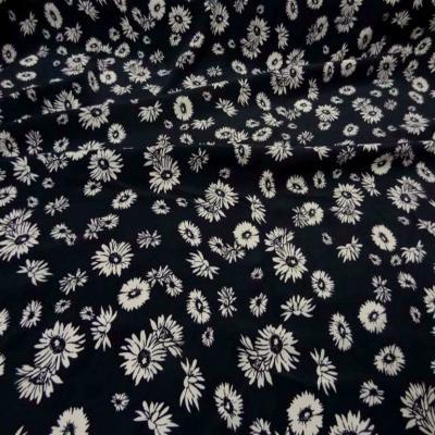 Crepe bleu nuit a fleurs blanche
