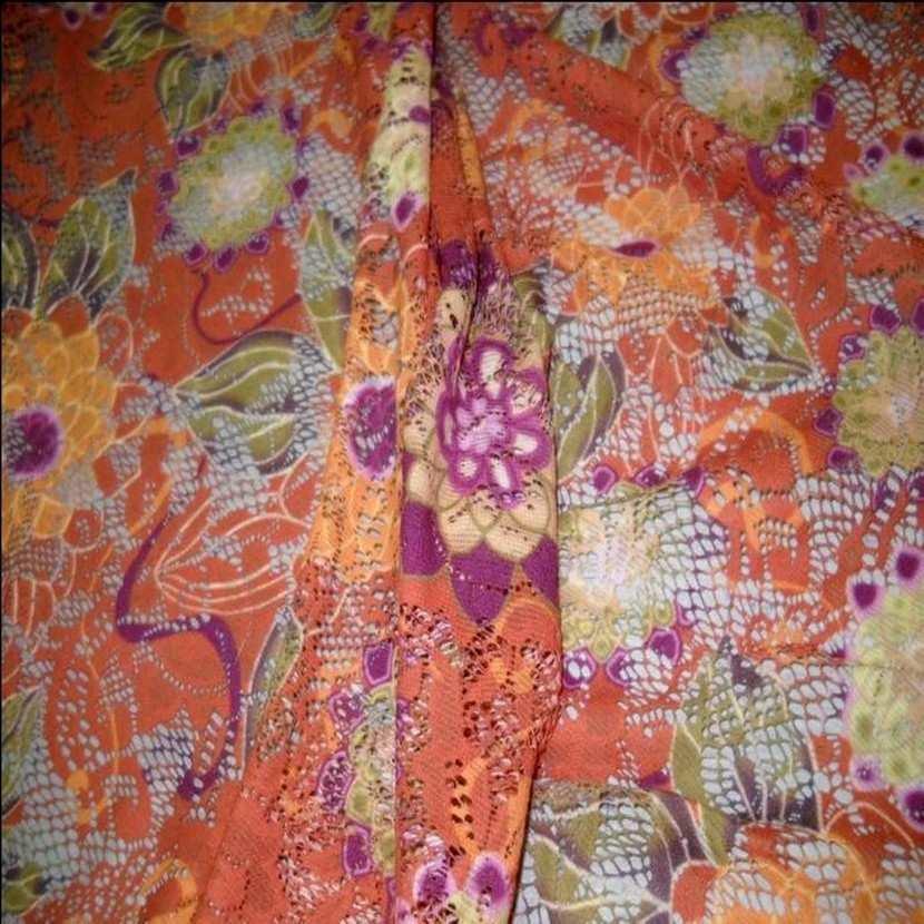 Dentelle lycra imprime fleurs ton orange