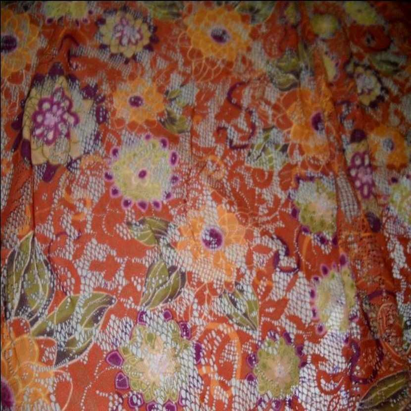 Dentelle lycra imprime fleurs ton orange0