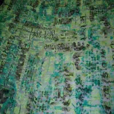Dentelle lycra imprime ton vert