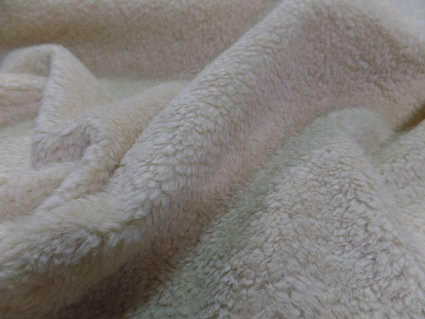Fausse fourrure aspect mouton ton naturel