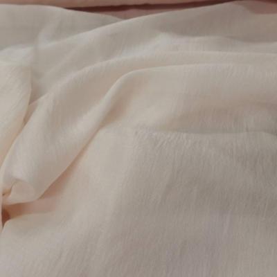 Gaze de soie beige rose clair