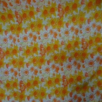 Jersey coton blanc imprime fleurs orange blanc