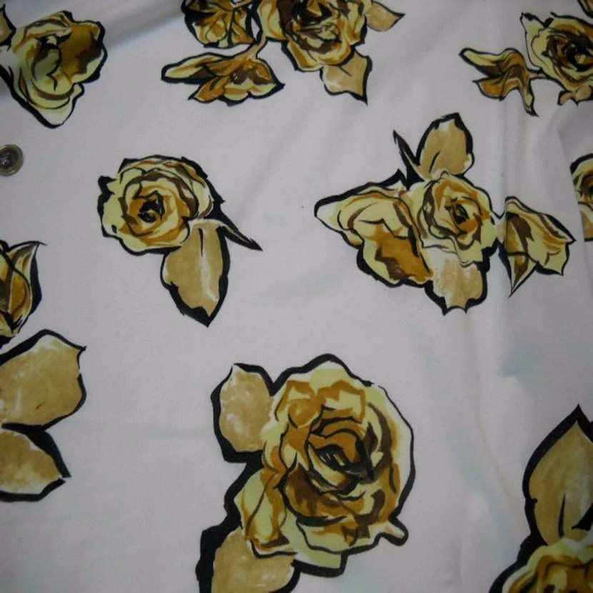 Jersey polyester blanc imprime rose ton beige jaune