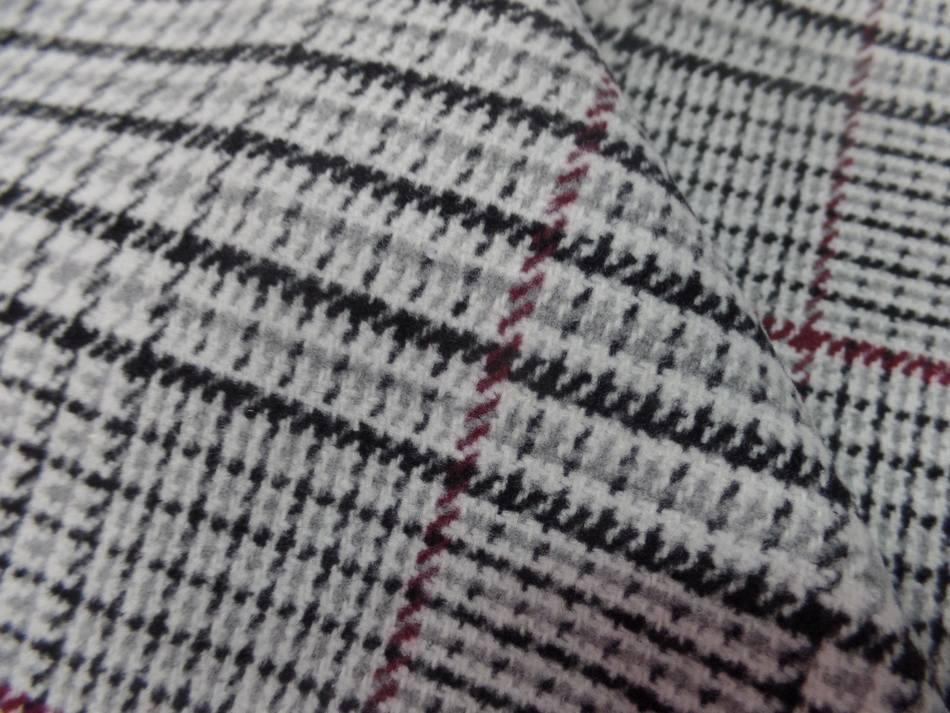 Lainage mélangé pied de poule motifs carreaux ton blanc et noir