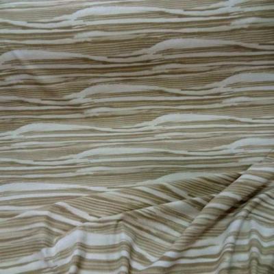 Lycra blanc imprime ton beige
