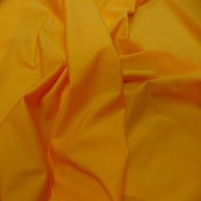 Lycra extensible dans le 2 sens jaune orange
