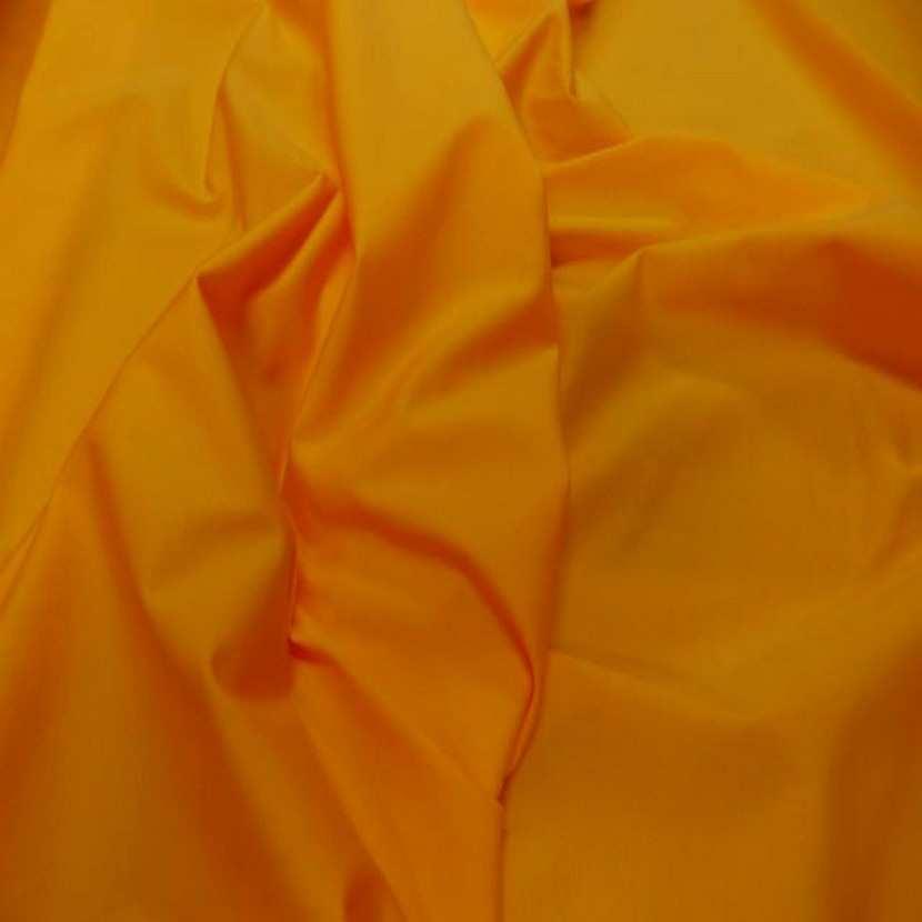 Lycra extensible dans le 2 sens jaune orange0