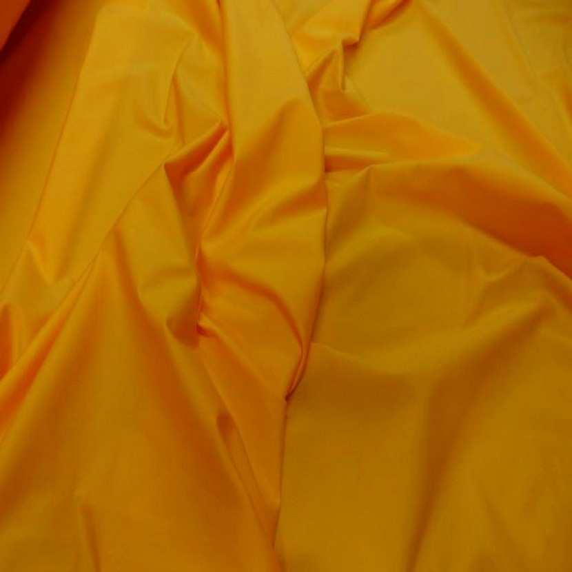 Lycra extensible dans le 2 sens jaune orange9
