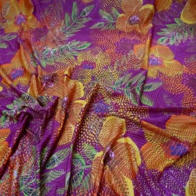 Lycra fuchsia imprime fleurs orange