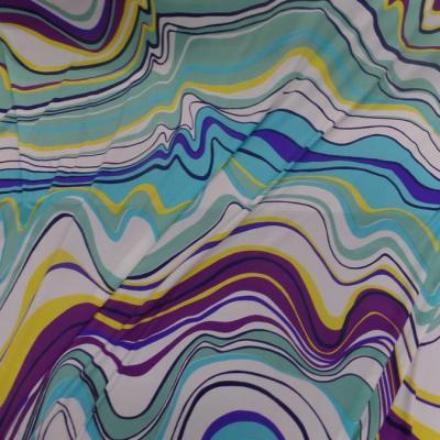 Lycra imprime annee 70 ton blanc bleu jaune et violet
