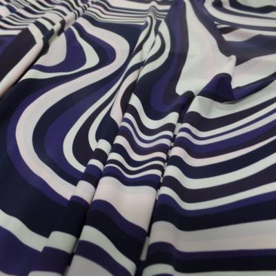 Lycra imprime annee 70 ton blanc violet rose et noir