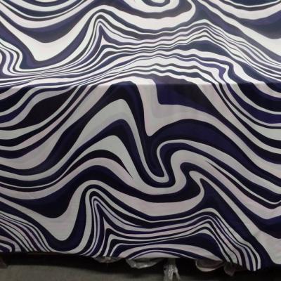 Lycra imprime annee 70 ton blanc violet rose et noir4