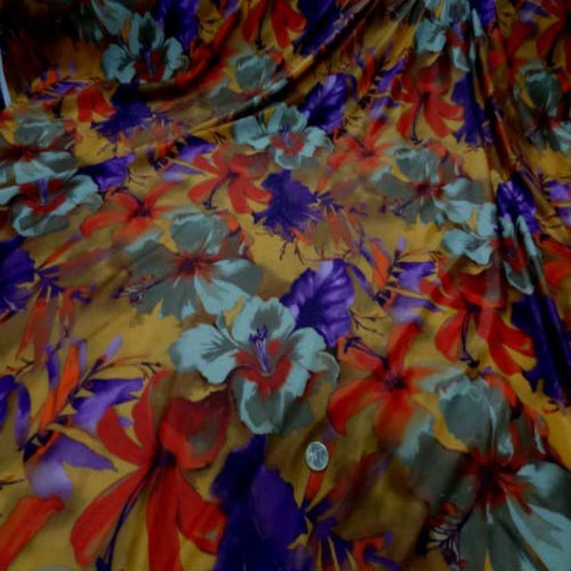 Lycra imprime fleurs safran prune