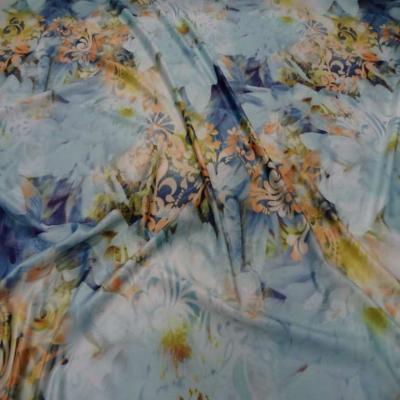 Lycra imprime fleurs ton bleu jaune safran