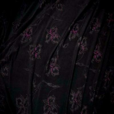Lycra noir faconne fleurs lurex rose