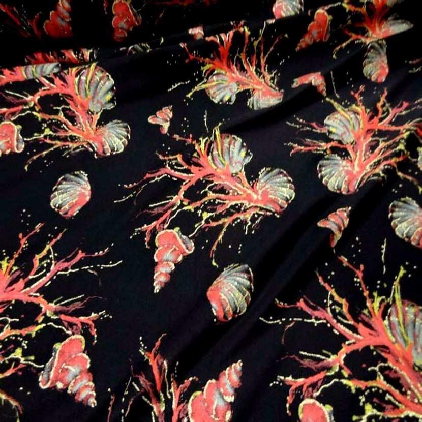 Lycra noir imprime coquillage corail lurex dore