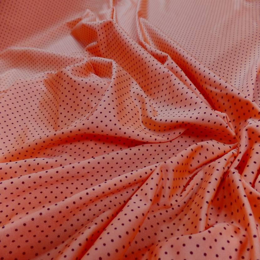 Lycra orange satine a petit pois noir