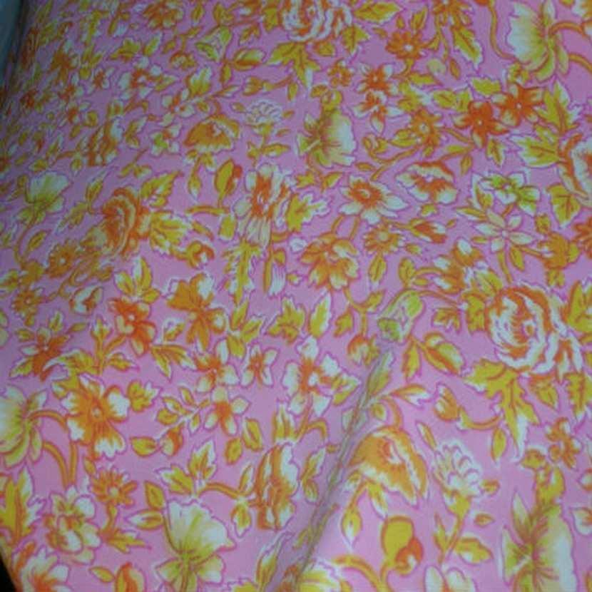 Lycra rose imprime fleurs jaune orange