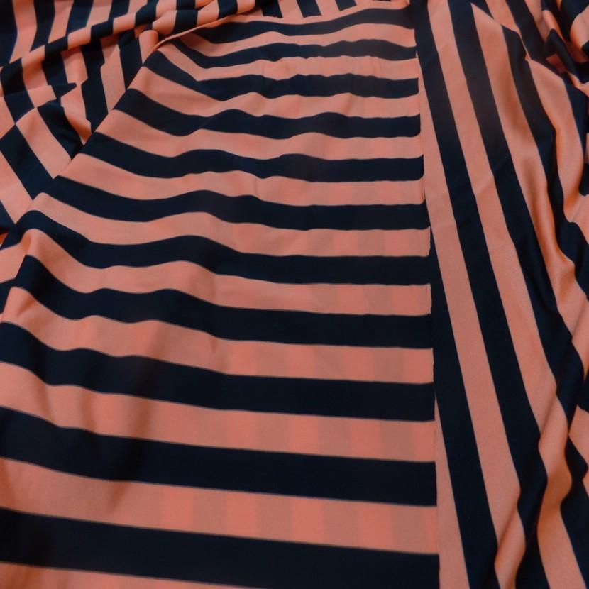 Lycra satine a rayure noire et orange