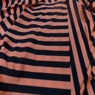 lycra satiné a rayure noire et orange