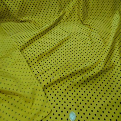 Lycra satine jaune a pois