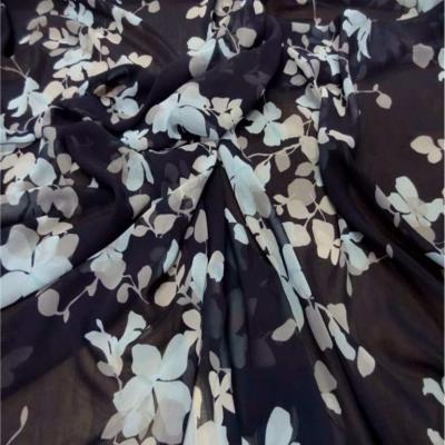 Mousseline imprime fleurs ton bleu tres fonce