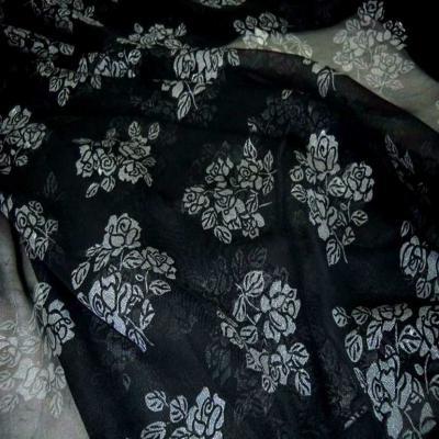 Mousseline ton noire imprime fleurs